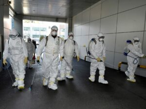 Men in white hazmat suits
